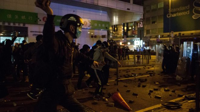 160209054115_a_protester_l_prepares_to_throw_a_brick_at_police_during_riots_in_mongkok_district_in_hong_kong_china_09_february_2016_976x549_epa_nocredit