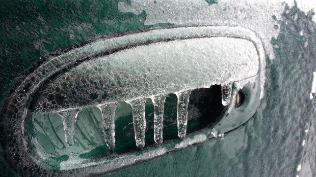 frozen-car-door-in-freezing-rain-storm