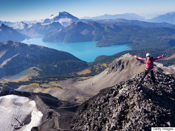 Woman on top of Black Tusk with Garibaldi Lake in the background