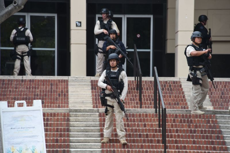 Members of security are seen on June 1, 2016 at the University of California's Los Angeles campus on June 1, 2016 in Los Angeles, California. Two people were confirmed dead on Wednesday following a shooting at the University of California's Los Angeles campus, police said.