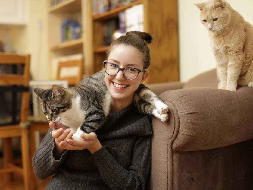 jose-cyr-hangs-out-with-two-of-her-three-cats-tut-and-bella