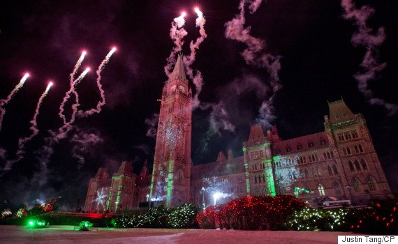 Pyrotechnics explode in front of the Peace Tower as Christmas lights illuminate Parliament Hill during the launch of Christmas Lights Across Canada in Ottawa on Wednesday, Dec. 3, 2014. THE CANADIAN PRESS/Justin Tang