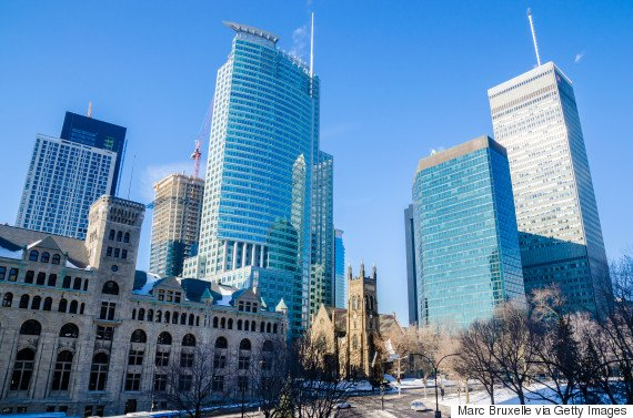 Montreal, Canada - March 6, 2016: St. George's Anglican Church with skyscrapers in the background, downtown, Montreal, Quebec, Canada