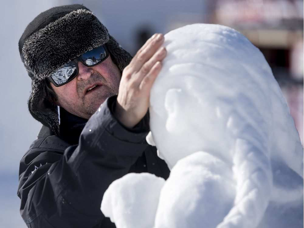 Daniel Gaudreault looks over his snow carving during the opening day of the 2017 Winterlude Festival at Jacques Cartier Park in Gatineau, Friday, February 3, 2017.