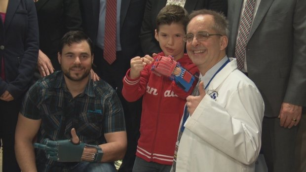 david-chasse-sebastian-chavarria-and-dr-frank-rybicki-pose-with-3d-printed-prosthetic-hands