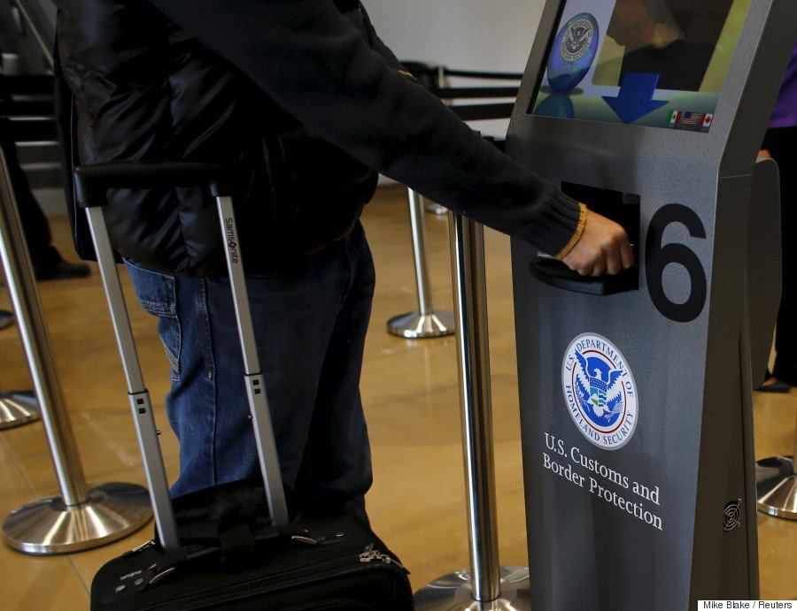 A traveler has his passport scanned as he passes through U.S. Customs and Immigration after using the Cross Border Xpress pedestrian bridge between San Diego and the Tijuana airport on the facility's opening day in Otay Mesa, California December 9, 2015. The privately run facility allows ticketed passengers to skip long border waits and clear U.S. Customs for a fee. REUTERS/Mike Blake