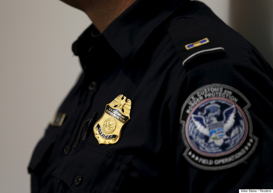 A U.S. Customs and Immigration officer works a new border crossing during the opening day of the Cross Border Xpress pedestrian bridge between San Diego and the Tijuana airport on the facility's opening day in Otay Mesa, California December 9, 2015. The privately run facility allows ticketed passengers to skip long border waits and clear U.S. Customs for a fee. REUTERS/Mike Blake